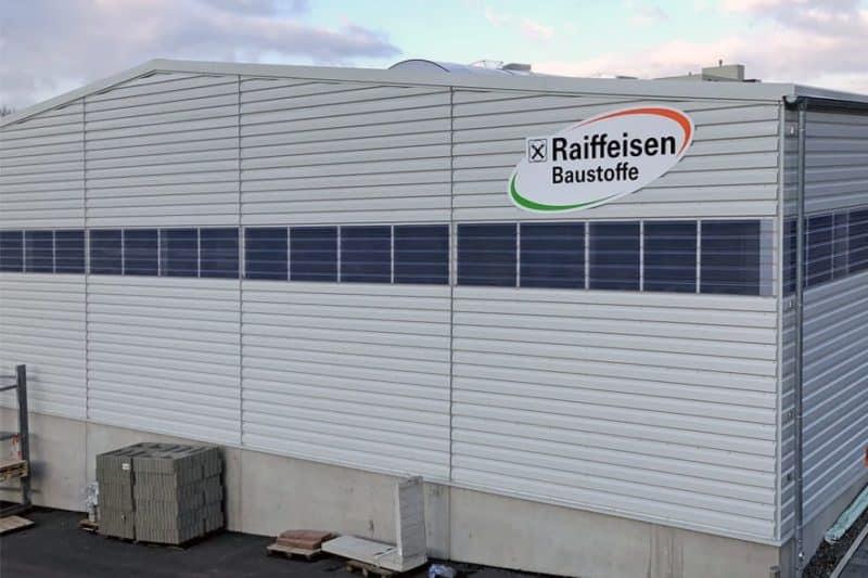 Fassadenwerbung Raiffeisen Baustoffe Hühnfeld